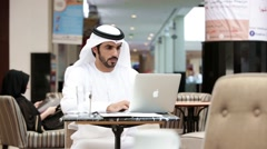 Businessmen using laptop at restaurant. Stock Footage