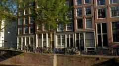 Pan across the footbridge over Brouwersgracht Stock Footage