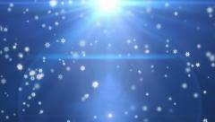 Flakes falling against light blue, holiday background - stock footage