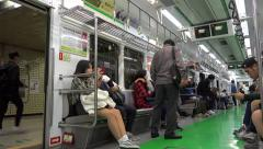 Passengers on a train Seoul Subway. South Korea Stock Footage