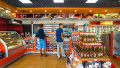 Stock Video Footage of 4K Timelapse. People buy in the store the gas station Gazpromneft. Camera 1