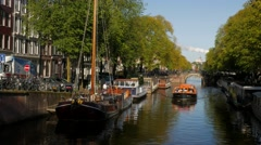 Amsterdam tour boat on Brouwersgracht Canal Stock Footage