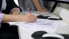 Hands of interior designers working with pen on map Stock Footage