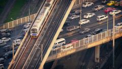 Subway Train Passes Over Cars On Highway Stock Footage