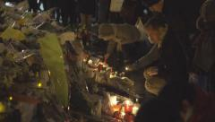 Paris terror attacks - Shrine at night, place de la République Stock Footage