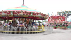 Merry Go Round And Pizza Stand At Carnival. Stock Footage