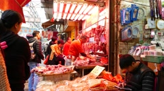 Dexterous chinese butcher in outdoor fresh meat shop, street stall Stock Footage