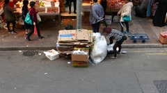Woman sort plastic waste and garbage on street Stock Footage