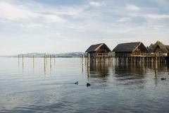 Stilt houses Unteruhldingen piledwelling museum UNESCO World Heritage Site - stock photo