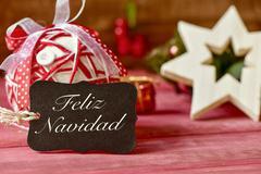 Text feliz navidad, merry christmas in spanish Kuvituskuvat