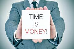 businessman with signboard with text time is money - stock photo