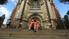 Young and beautiful couple hugging on the background the church Stock Footage