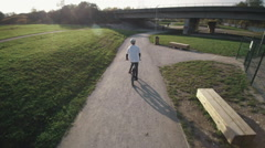 A bmx athlete riding on a path Stock Footage