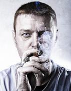 Portrait of a man smoking - stock photo
