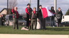People with flags wait funeral procession for fallen Canadian soldier from Syria Stock Footage