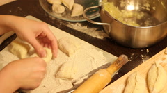 Rolling out dough with a rolling pin in hand Stock Footage