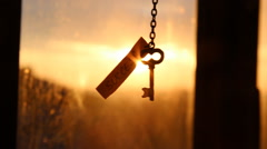 Golden key to success idea, sunset. Stock Footage