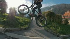 A bmx athlete grinding a rail Stock Footage