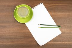 Blank paper with coffee on table Stock Photos