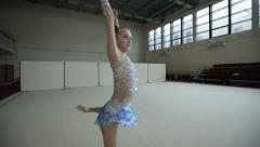Rhythmic gymnastics: Teenager training a gymnastics exercise with a ball Stock Footage