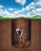 Businessman digs a tunnel - stock photo