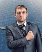 Businessman with hand over heart Stock Photos