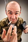 Impudent bandit with gun - stock photo