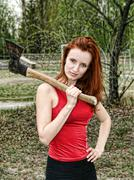 Woman with axe - stock photo