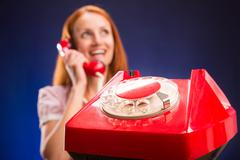 Woman with red telephone Stock Photos