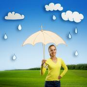 Happy smiling young woman with umbrella Stock Photos