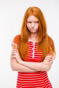 Cute offended girl standing with hands crossed Stock Photos