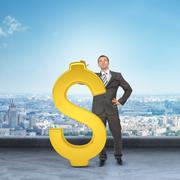 Businessman leaning on big dollar sign Stock Photos