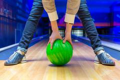 Beginner aiming to bowling pins Stock Photos