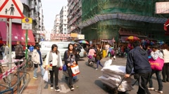 POV struggle forward along usual crowded street, cheap shopping area Stock Footage