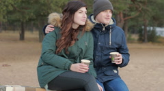 Healthy young couple taking time alone together wearing warm clothing sitting Stock Footage
