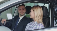 Salesman hands over the keys to the buyer - stock footage