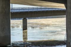 Mist on Icy River under Bridge - stock photo
