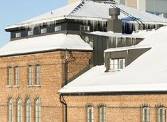 Icicles Hanging from Roof Stock Photos