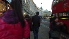 Walking down Regent Street London Romantic Couple Stock Footage
