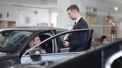 Salesman explains the procedure of buying a car - stock footage