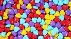Background of colored candy in heart shape Stock Footage