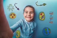 Self teen girl smiling happy icons biology education formation o Kuvituskuvat