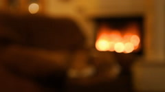 Dog in sofa at home in evening and Beautiful view on fire in fireplace Stock Footage