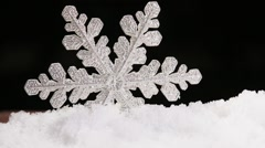 brilliant white snowflake on a snow - stock footage