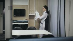 Hotel: Maid cleans the room at the hotel - stock footage