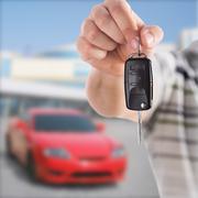 Handing car key - stock photo