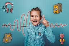 Teen girl held up a finger up laughing opening of the sound wave Stock Photos