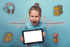 teen girl holding a tablet opened her mouth screaming sound wave - stock photo