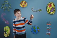teenage boy laughing and holding a finger pleased icons biology - stock photo
