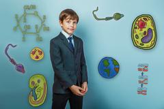 Teenage boy smiling businessman standing arms crossed icon set E Stock Photos